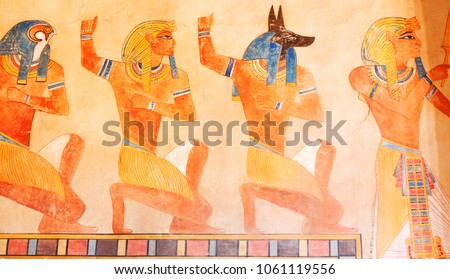ncient egypt scene. Hieroglyphic carvings on the exterior walls of an ancient egyptian temple. Grunge ancient Egypt background. Hand drawn Egyptian gods and pharaohs. Murals ancient Egypt. #1061119556