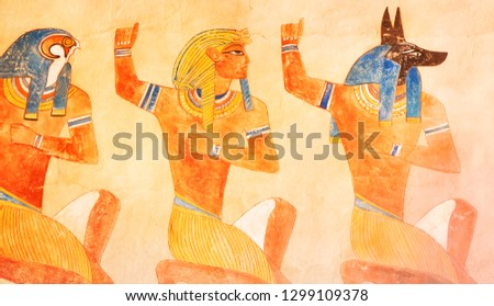 ncient egypt scene. Hieroglyphic carvings on the exterior walls of an ancient egyptian temple. Grunge ancient Egypt background. Hand drawn Egyptian gods and pharaohs. Murals ancient Egypt.
