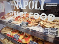 Neapolitan Street food stand. Calzone fritto, Pagnottiello and Pizza among the traditional dishes offered for sale