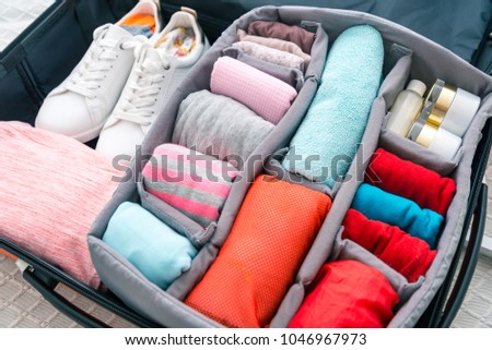 neatly folded clothes in a suitcase