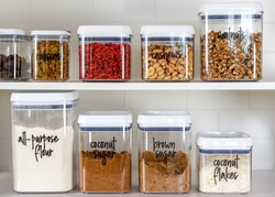 Neatly organized and labeled baking ingredients in BPA-free plastic storage containers