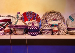 Neatly woven colourful baskets made of date palm leaves