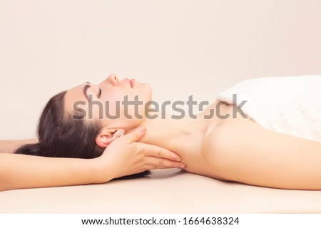 neck massage in a spa salon for a girl. concept of health massage. light background. Photo stock ©