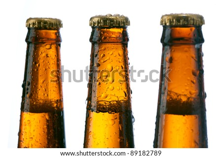 neck of a beer bottle with a lid over white
