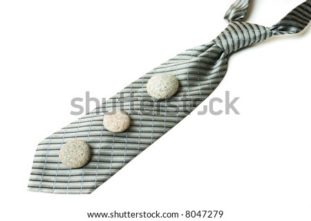 Neck tie and pebbles isolated on white