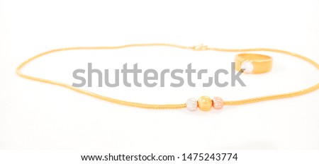 Necklace and ring placed on a white background #1475243774