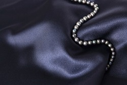 necklace black pearl on a blue background