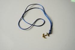 Necklace nautical with anchor charm. Necklace design with gold charm style
