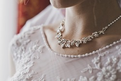 Necklace on womans neck.