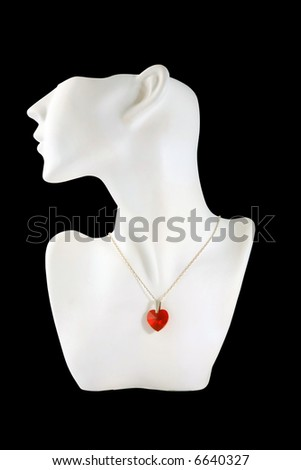 Necklace with a white mannequin on a black background.