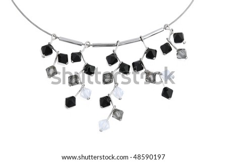 Necklace with black, grey and white crystals isolated on white. Close up