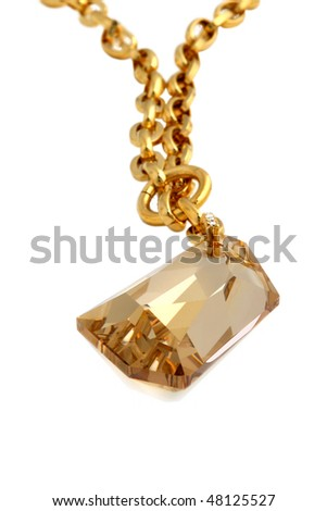 Necklace with sparkling crystal. Isolated on white background.