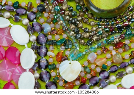 Necklaces and bracelet on green paper