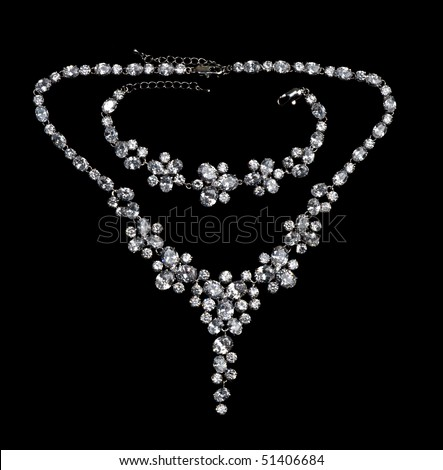 necklaces with precious stones on a black background
