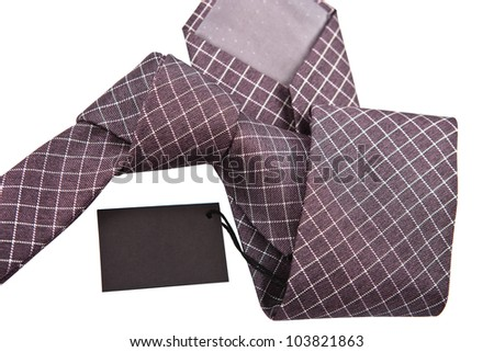 necktie with label close up on white background