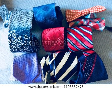 Neckties. Set different neckties. Colored tie for men. Set of stylish men accessories, men's fashion. Collection of coiled neckties in display. Sakura necktie. Bow tie. - Shutterstock ID 1103337698