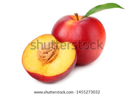 Nectarine with green leaf and slices isolated on white background
