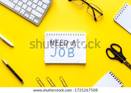 Need a job, looking for. Text on yellow office desk top-down flat lay
