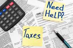 Need help and taxes text on stickers with tax forms. Assistance with filing tax form and calculation.