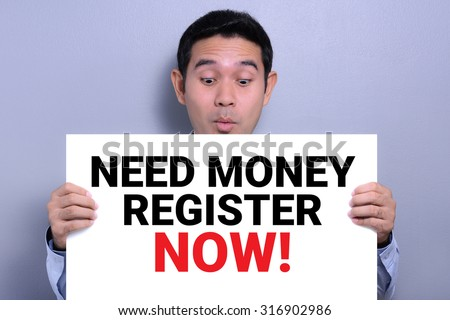 NEED MONEY REGISTER NOW! message on white paper held by a man with excited face