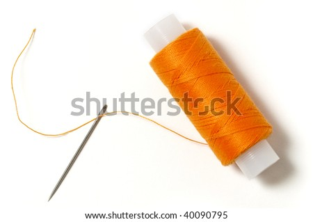 Needle and thread isolated over white background
