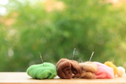 Needle felting, fluffy hairy craft from sheep or animal hair to make doll or handicraft decoration with small needdle. Hand made design craft.