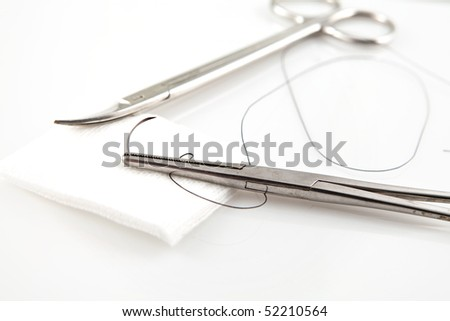 Needle Holders With Suture And Scissors