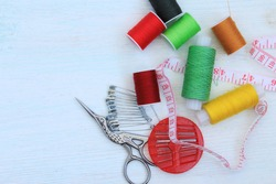 Needlework. Threads, scissors, tape measure, pins. Materials for creative work. Female hobb concept. Everything for creativity. Copy space.