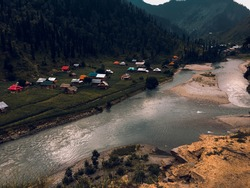 Neelum River flowing through Azad Jammu and Kashmir with houses on one side