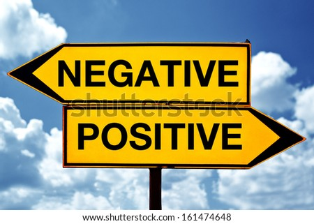 Negative versus positive, opposite direction signs on the street