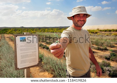NEGEV DESERT - APRIL 06: An Israeli farmer during desert farming on April 06 2011 in the Negev, Israel.Israel is a world-leader in agricultural technologies despite its dry climate.