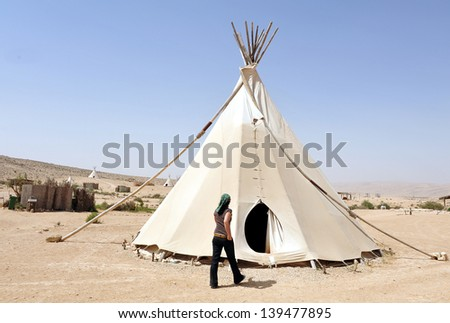 NEGEV,ISR - FEB 15:Woman live in Tipi on February 15 2011.Painted  plains Indians tipis were mainly featured geometric portrayals of celestial bodies, war battles and animal designs.