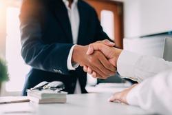 Negotiating business,Image of businessmen Handshaking,Handshake Gesturing People Connection Deal Concept