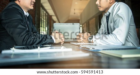 Negotiation of two statesman with clasped hands in office. Two men's hand on a desk. Negotiating business concept. #594591413