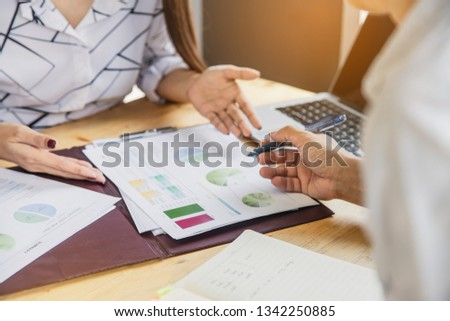Negotiation of two statesman with clasped hands in office. Two men's hand on a desk with contract . Negotiating business concept. #1342250885