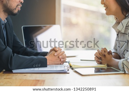 Negotiation of two statesman with clasped hands in office. Two men's hand on a desk with contract . Negotiating business concept. #1342250891