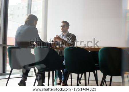 Negotiations process behind wall door concept, human resources manager interviewing candidate of company position, two businessmen business meeting, insurance broker makes offer deal with firm client