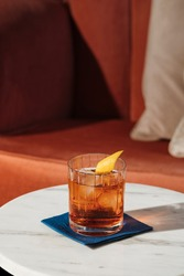 Negroni, an italian IBA cocktail with gin, bitter and vermouth; in luxury elegant home, homemade drink