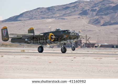 NELLIS AFB, LAS VEGAS, NV - NOVEMBER 14: B-25 Mitchell vintage WWII-era bomber aircraft landing after performing at Aviation Nation 2009 on November 14, 2009 in Nellis AFB, Las Vegas, NV