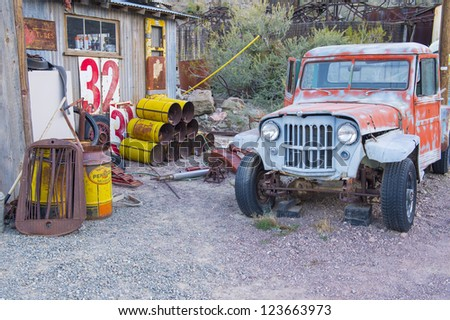 NELSON , USA - NOV 25 : Old wooden house and rusty old car in Nelson Nevada ghost town on November 25 ,2012 - stock photo
