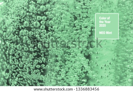 Neo mint colors air bubbles in water. Abstract background.Macro. Water drops bubbles on a neo mint background. Neo mint color of the year 2020. #1336883456