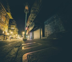 Neo noir style image of Chinatown at night in San Francisco