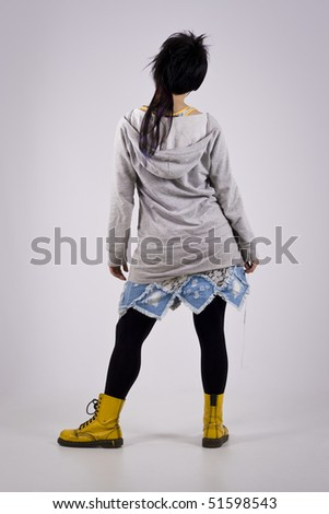 stock-photo-neo-punk-girl-standing-holding-a-neck-chain-51598543.jpg