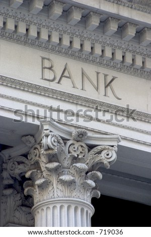 "Neoclassical architecture sports a column with the word ""BANK"" above it."