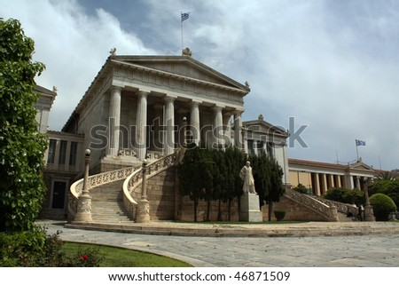 Neoclassical National Library in Athens, Greece, with marble staircase and doric columns.
