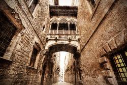 neogothic bridge at Carrer del Bisbe (Bishop Street) - picture in artistic retro style