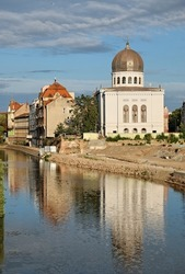 Neolog Synagogue Zion reflecttion on Crisul Repede River in Oradea, Romania
