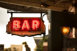 Neon bar sign hangs along Bourbon Street in the French quarter of New Orleans Louisiana USA in the French quarter of New Orleans Louisiana USA