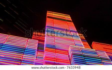 Neon color skyscrapers in night - stock photo
