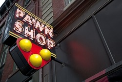 Neon pawn shop sign.